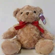 Cream teddy bear with red ribbon neck tie